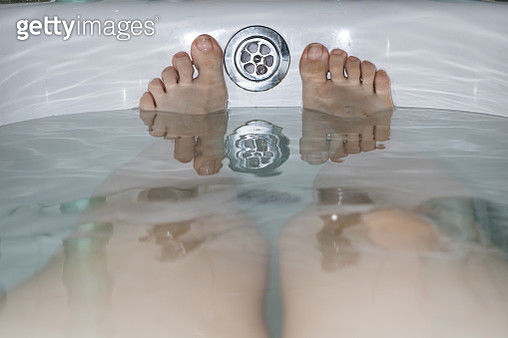 Low Section Of Woman In Bathtub - gettyimageskorea