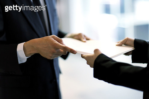 Close up of business people holding paperwork in city night - gettyimageskorea