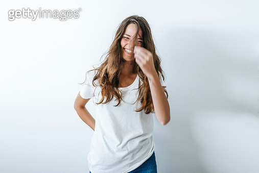 Portrait of smiling woman with hairs on her face in white background - gettyimageskorea