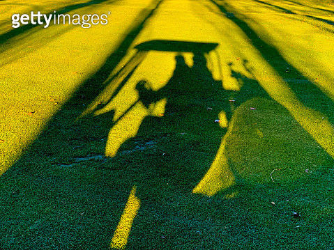 Shadow of a Man Travel with a Golf Cart on Golf Course - gettyimageskorea