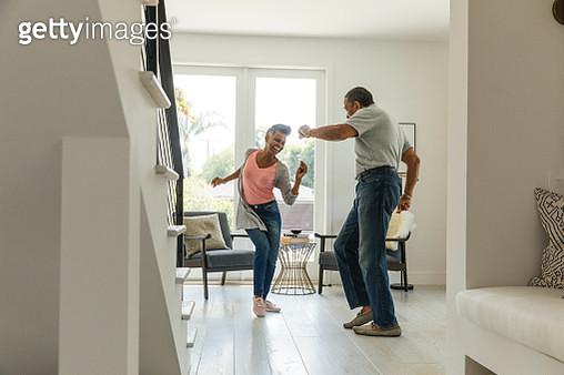 Mature couple dancing in living room - gettyimageskorea