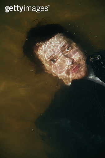 19 century styled man underwater. Photo stylized like oil painting. Nicely fit for book cover - gettyimageskorea