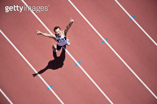 Runner cheering on track - gettyimageskorea