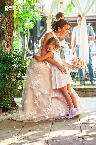 Daughter Hugging Her Mother Bride. - gettyimageskorea