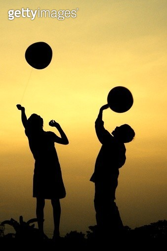 Children playing with balloons - gettyimageskorea