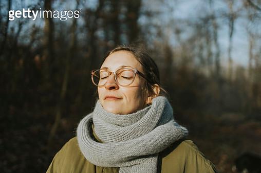 Portrait of woman during sunbath in winter - gettyimageskorea