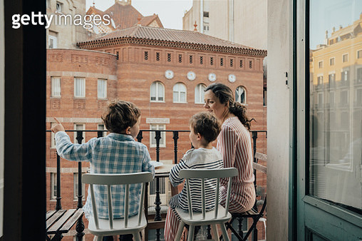 Family on balcony - gettyimageskorea