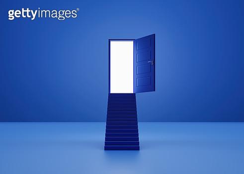 Stair leading to an illuminated door - gettyimageskorea