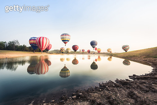 Reflection Of Hot Air Balloons On Lake Against Sky - gettyimageskorea