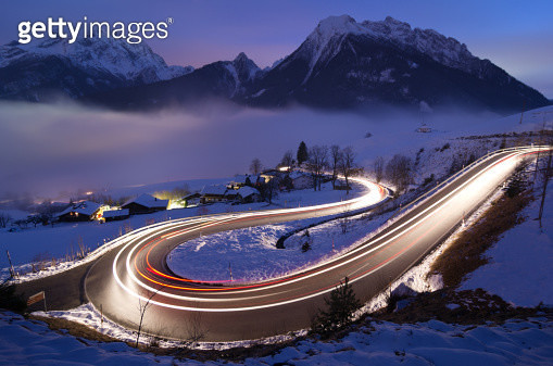 Light trails on German mountain road in winter - gettyimageskorea