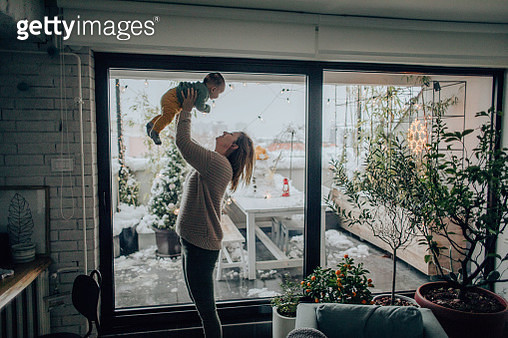 Baby boy and his mom in their apartment - gettyimageskorea