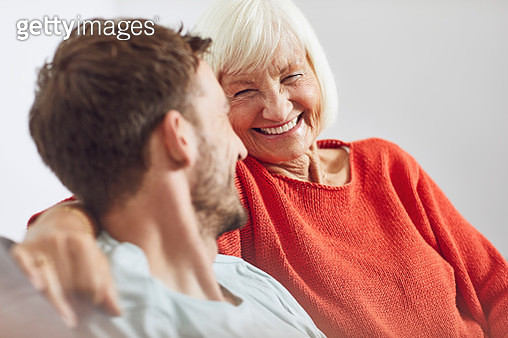 Portrait of senior woman with her grown-up grandson - gettyimageskorea