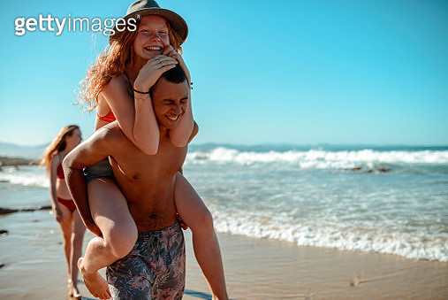 Loving couple at the beach - gettyimageskorea