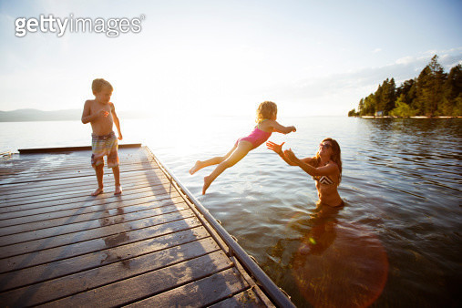 Swimming in a lake. - gettyimageskorea
