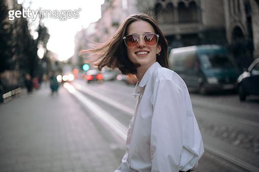 Happy girl in sunglasses on street - gettyimageskorea