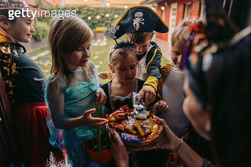 Group of kids trick or treating - gettyimageskorea