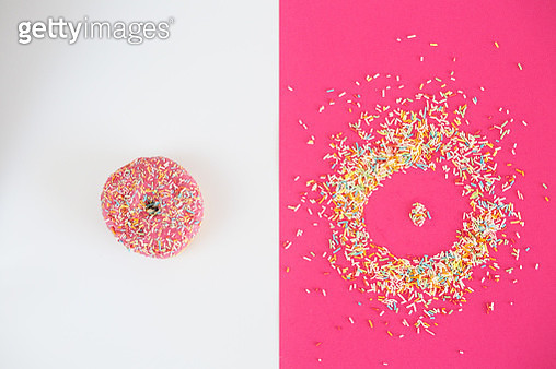 Donut covered in sprinkles and donut shape - gettyimageskorea