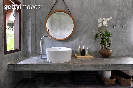 Vanity in a luxury concrete bathroom - gettyimageskorea