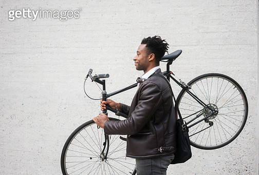Young businessman with bike - gettyimageskorea