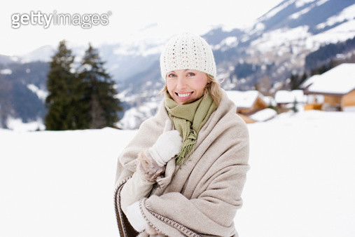 Woman wrapped in blanket - gettyimageskorea