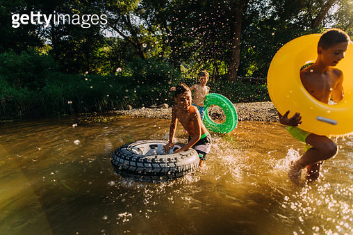 Boys spending summer day on the river - gettyimageskorea