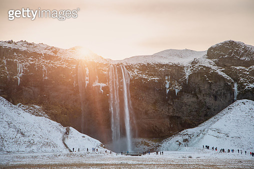 Winter sunrise over waterfall ridge in winter, Iceland - gettyimageskorea