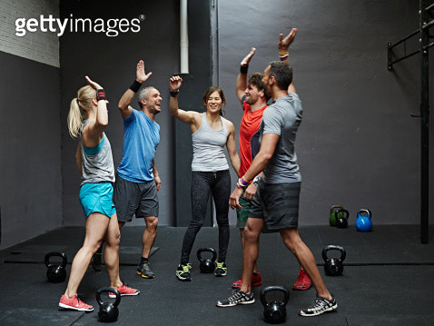 Group of gymters celebrating workout after class - gettyimageskorea