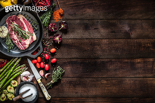 Roasting a beef steak and vegetables on an iron grill with copy space on the table - gettyimageskorea