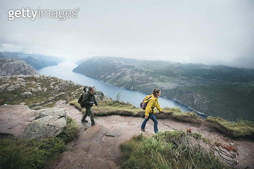 Father with daughter wallking in high mountains in Norway - gettyimageskorea