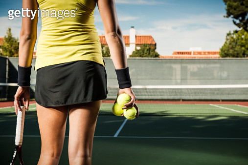 Female tennis player holding balls - gettyimageskorea