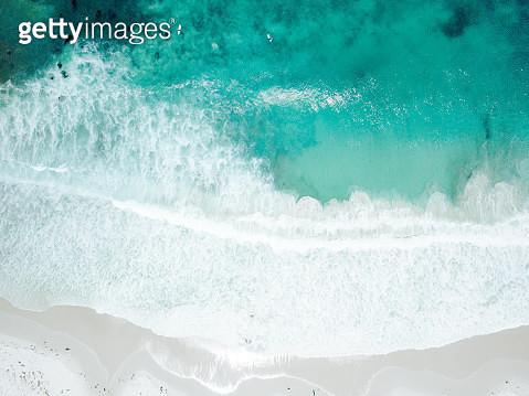 Aerial view of Waves Crashing on Sandy Beach - gettyimageskorea