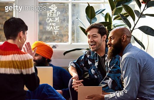 Creative team sharing a joke together in workshop - gettyimageskorea