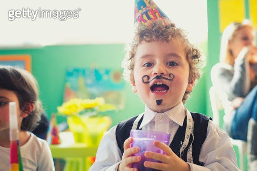 Portrait of a small boy on a birthday party - gettyimageskorea