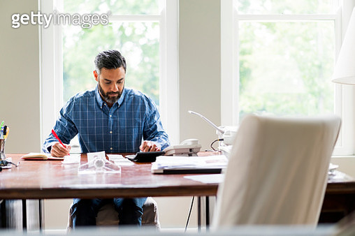 Businessman working in home office - gettyimageskorea