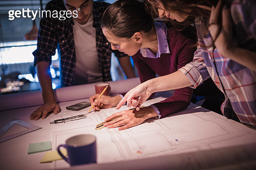 Creative, young, office coworkers, designers and architects, talking during meeting together in design studio - gettyimageskorea