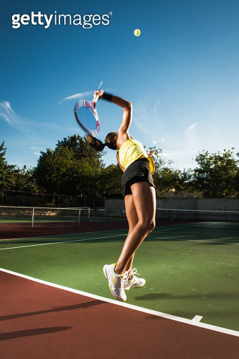 Female tennis player hitting ball - gettyimageskorea