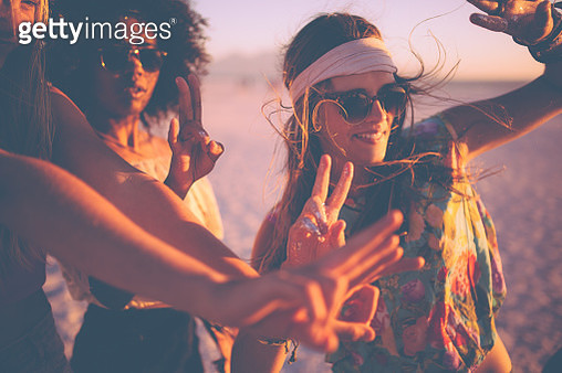 Girls dancing at a beachparty at sunset - gettyimageskorea