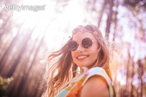 Boho girl in flower headband and round sunglasses - gettyimageskorea