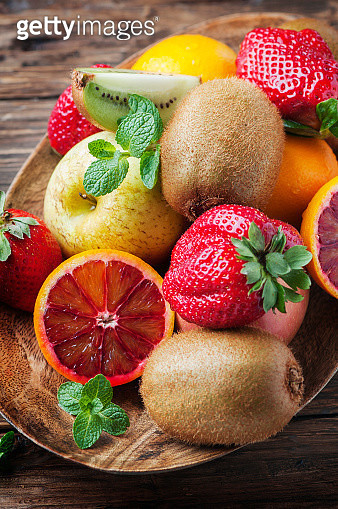 Mix of fresh fruits on the wooden table - gettyimageskorea