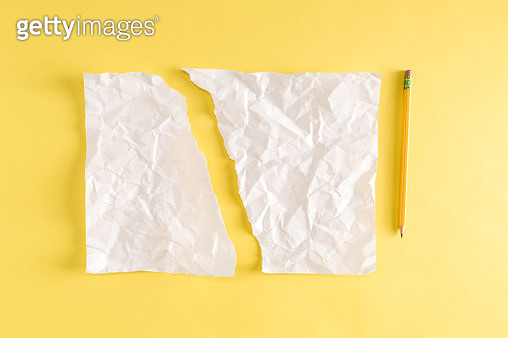 Torn piece of paper and a pencil on yellow - gettyimageskorea