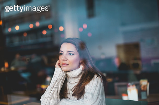 Lonely girl in cafe - gettyimageskorea