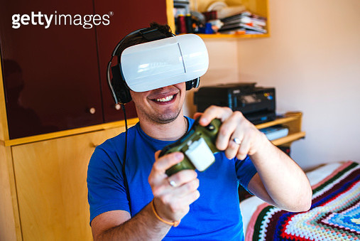 Young Man wearing Virtual Reality Glasses - gettyimageskorea