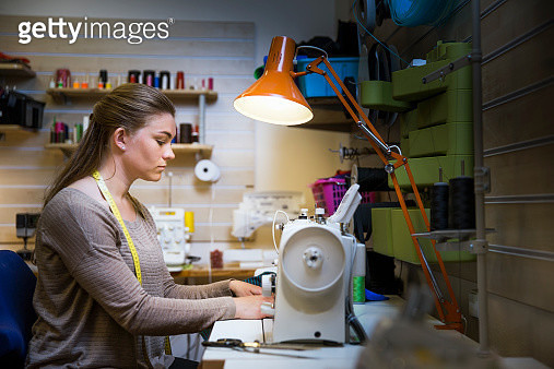 Female fashion designer using sewing machine - gettyimageskorea