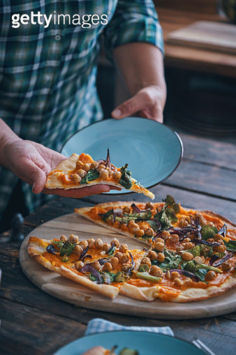 Preparing Vegan Pumpkin Pizza with Broccoli, Chickpeas and Spinach - gettyimageskorea