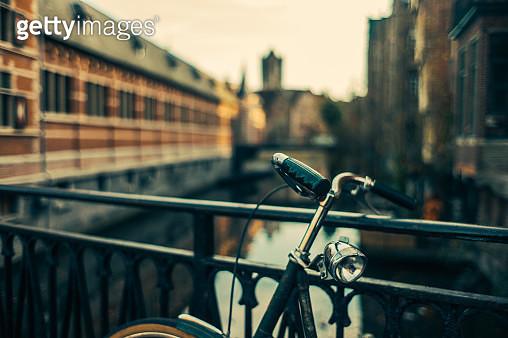 Bicycle against fence in bridge - gettyimageskorea