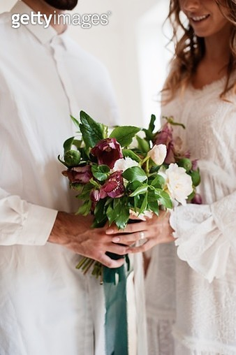 Midsection Of Bride And Bridegroom Holding Bouquet - gettyimageskorea