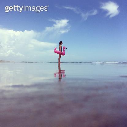 Girl Wearing Inflatable Flamingo Inner Tube - gettyimageskorea