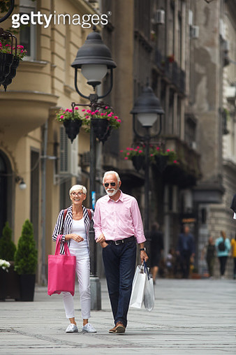 Senior couple in the city after shopping - gettyimageskorea