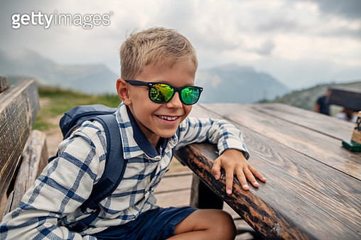 Little hiking sitting on table on Monte Baldo near Lake Garda, Italy - gettyimageskorea