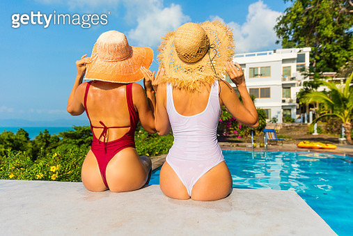 Couple woman in the swimming pool - gettyimageskorea